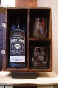 Wodden Box with Bottle of Three Cord Bourbon and two Old Fashioned Glasses